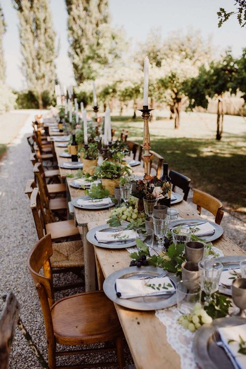 Rustic Wedding In Italy At Locanda Rosa Rosae With Intimate Candle Lit Dinner At Wooden Table With Fresh Fruit Decor