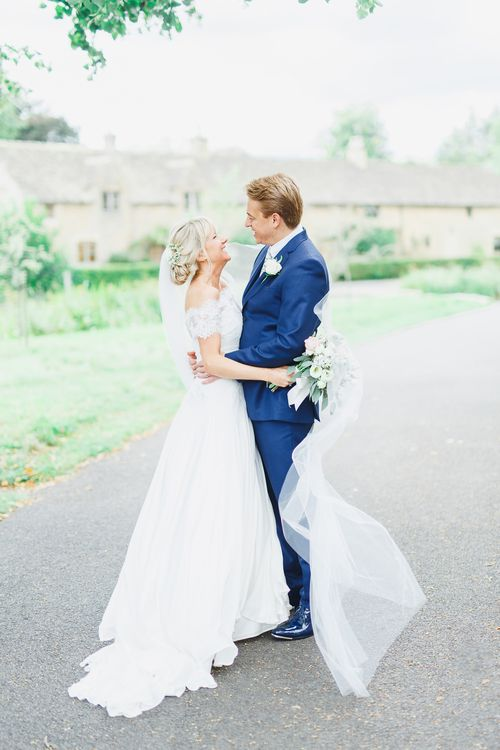 Bride in Naomi Neoh Loretta Gown with Stewart Parvin Lace Jacket & Suzanne Neville Belt | Groom in Navy Ted Baker Suit