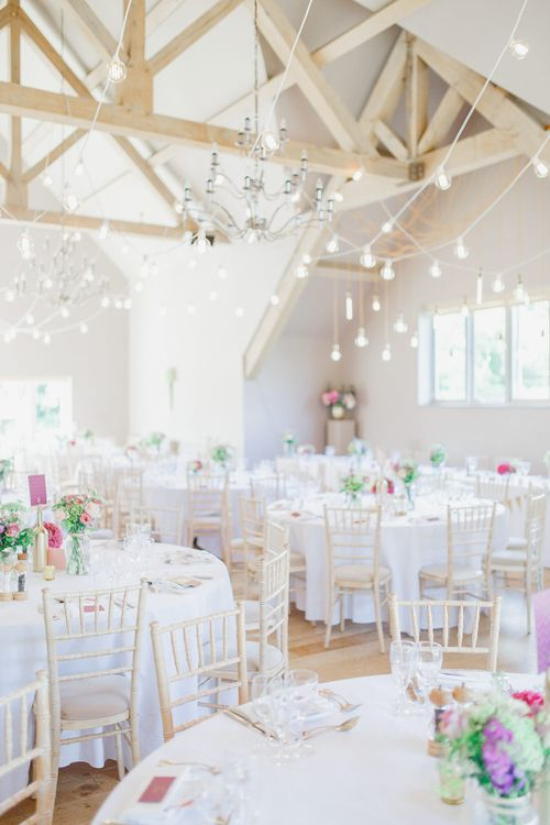 Barn Reception with Pink Flowers & Hanging Lights