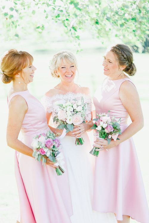 Bridesmaids in Pink Alfred Sung Dresses