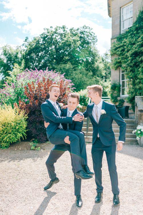 Groomsmen in Next Suits