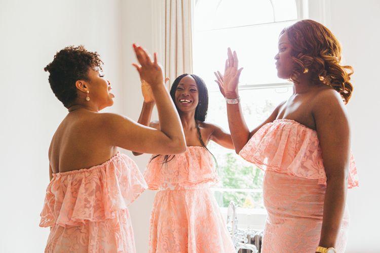 Bridesmaids In Pink Ruffled Dresses