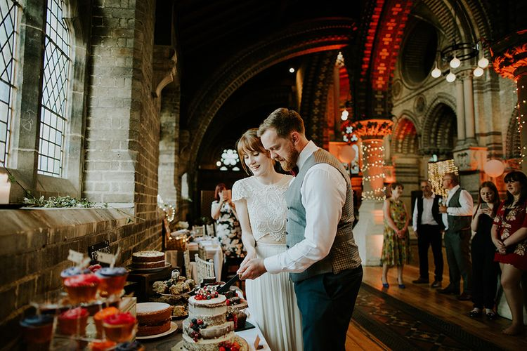 Cutting the Cake | Bride in Inbal Raviv Gown | Groom in Hugo Boss Suit | Luxe Wedding at St Stephen's Trust, Deconsecrated Church in Hampstead, London | Irene yap Photography