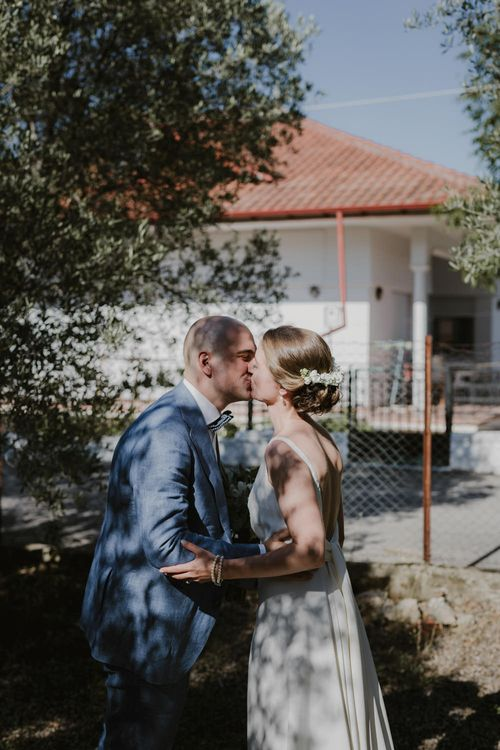 First Look | Bride in Yvonne Läufer Bridal Gown | Groom in Blue Suit Supply Suit | Outdoor Countryside Wedding in Greece Planned by Phaedra Liakou | Days Made of Love Photography