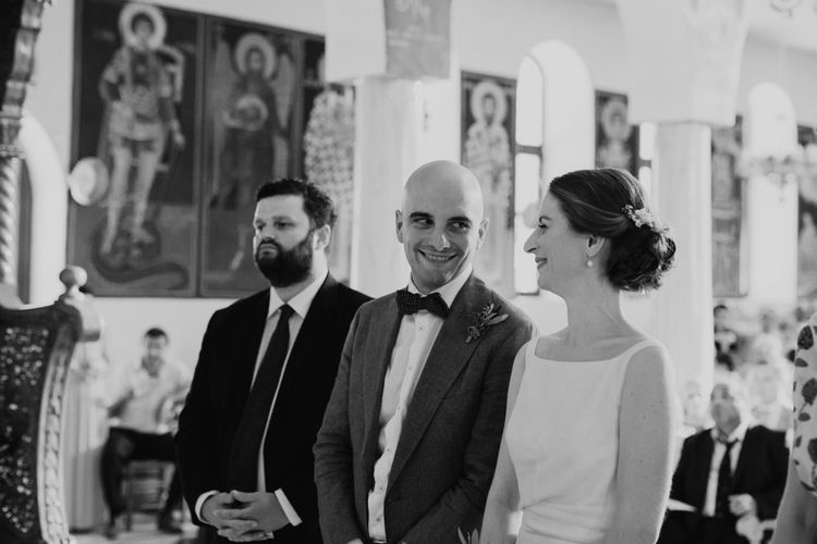 Wedding Ceremony | Bride in Yvonne Läufer Bridal Gown | Groom in Blue Suit Supply Suit | Outdoor Countryside Wedding in Greece Planned by Phaedra Liakou | Days Made of Love Photography