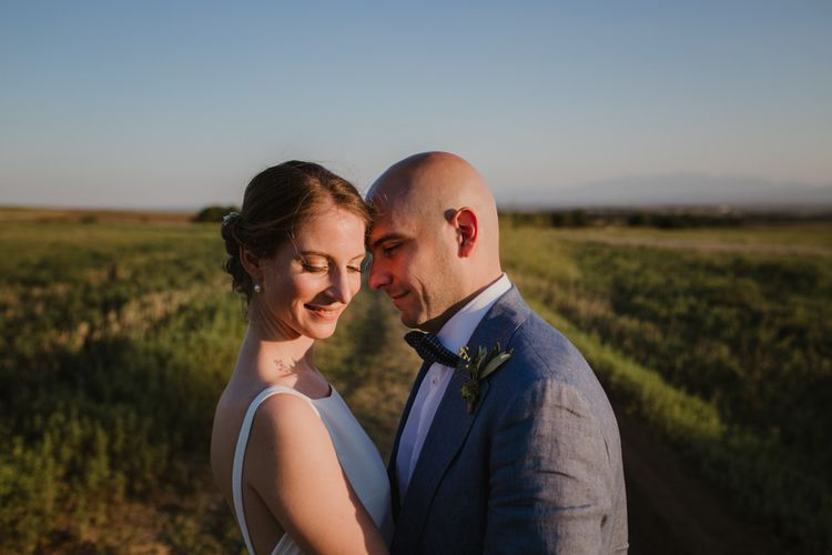 Bride in Yvonne Läufer Bridal Gown | Groom in Blue Suit Supply Suit | Outdoor Countryside Wedding in Greece Planned by Phaedra Liakou | Days Made of Love Photography