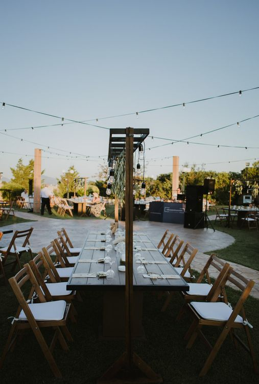 Trestle Tables with Festoon Lights | Outdoor Countryside Wedding in Greece Planned by Phaedra Liakou | Days Made of Love Photography