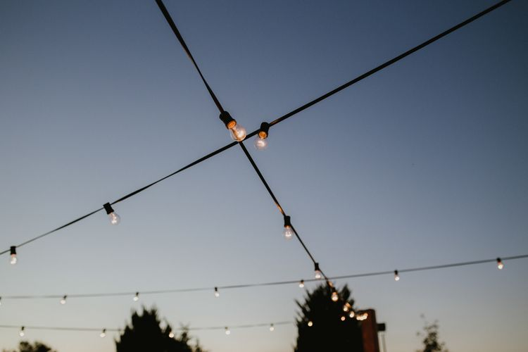 Festoon Lights | Outdoor Countryside Wedding in Greece Planned by Phaedra Liakou | Days Made of Love Photography