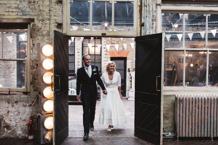 Bride In Delphine Manivet Wedding Dress
