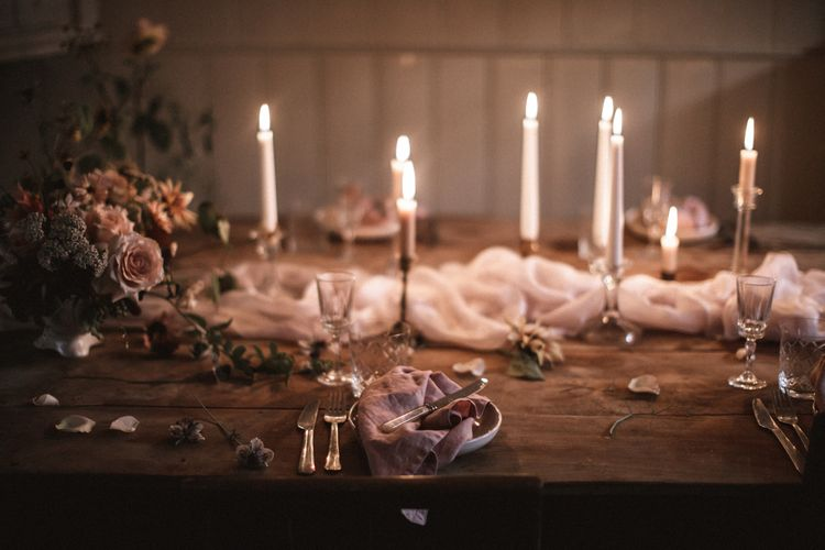 Short Cream Candles by Nordic House // Tall White Candles by Charles Farris // Vintage Glass & Copper Candlestick Holders to hire by Beatnik Bride // Silk Table Runner by Pompom Blossom // Linen Napkins & Plates by H&M Home // All vintage glassware and cutlery to hire by Beatnik Bride