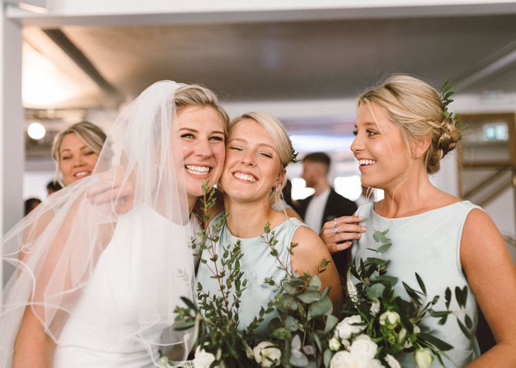 Bride in Pronovias Gown | Bridesmaid in Pale Green Ghost Dress | The Harbour Church Portsmouth Wedding | Emily & Steve Photography