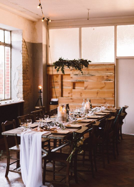 Rustic Trestle Table with Hanging Greenery Decor | The Harbour Church Portsmouth Wedding | Emily & Steve Photography