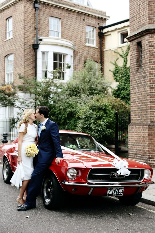 Red Mustang | Bride in Contemporary J Mendel Wedding Dress | Groom in Gieves & Hawkes Suit | Dasha Caffrey Photography