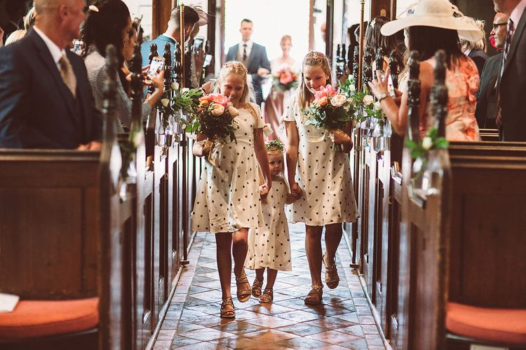 Bridesmaids In Copper Skirts With Cream Tops