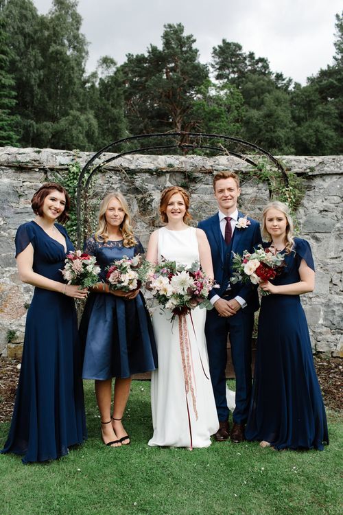 Bridesmaids In Navy Biba Dresses // Outdoor Wedding In Scotland With Burgundy, Pink & Navy Colour Scheme Images From Caro Weiss Photography & Bespoke Stationery From de Winton Paper Co