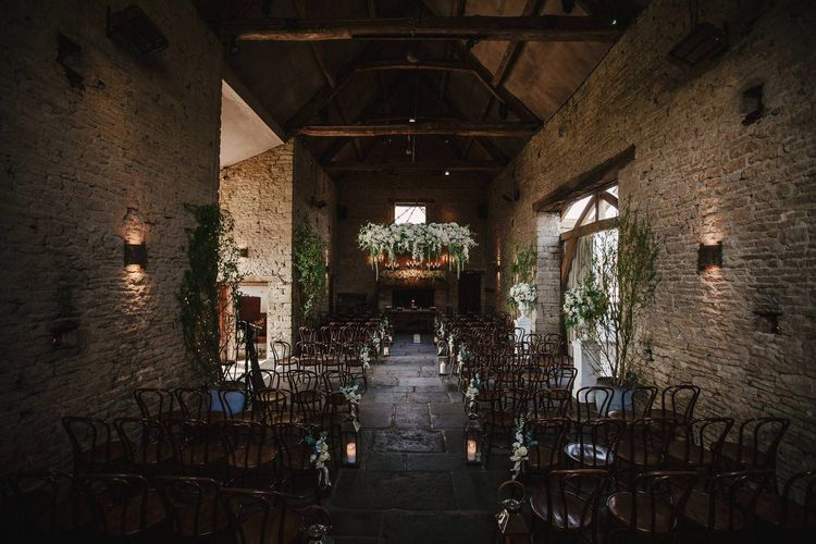 Cripps Barn Ceremony Room | Hanging Floral Display | Aisle Chair Decor | Andy Gaines Photography | Thompson Granger Films
