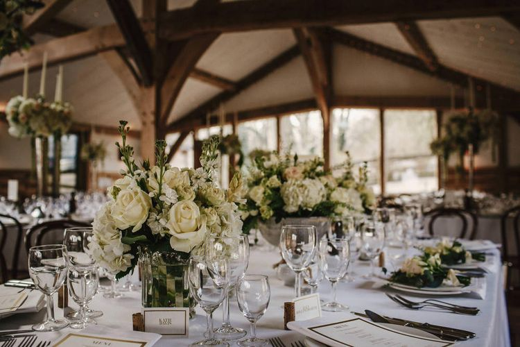 White Floral Centrepieces | Cripps Barn Wedding | Andy Gaines Photography | Thompson Granger Films