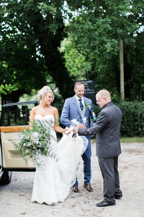 Bride with Foliage Filled Bouquet by Frog Manchester