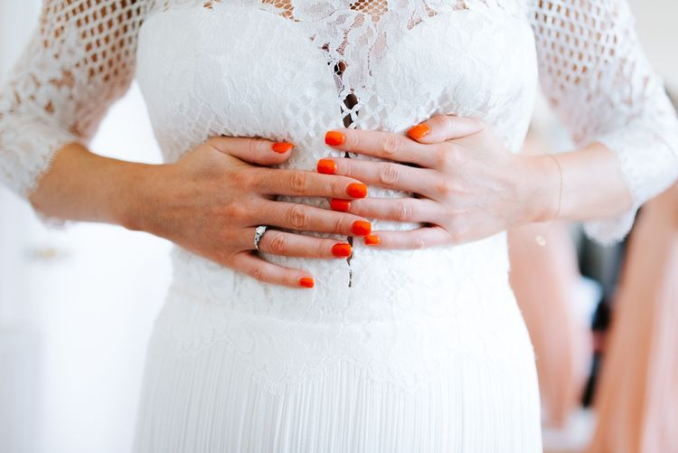 Bride With Orange Red Nails