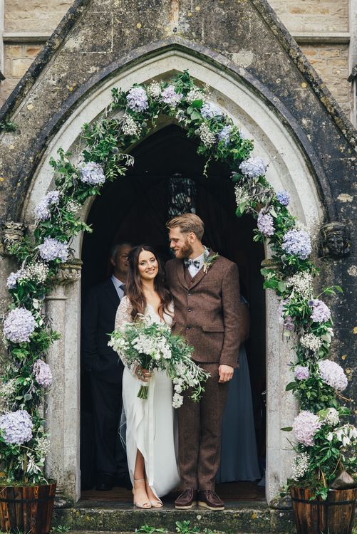 Church Floral Arch | Bride in Suzanne Neville Scarlet Gown | Groom in Harris Tweed Suit | DIY Woodland Wedding in South Wales | Cat Beardsley Photography