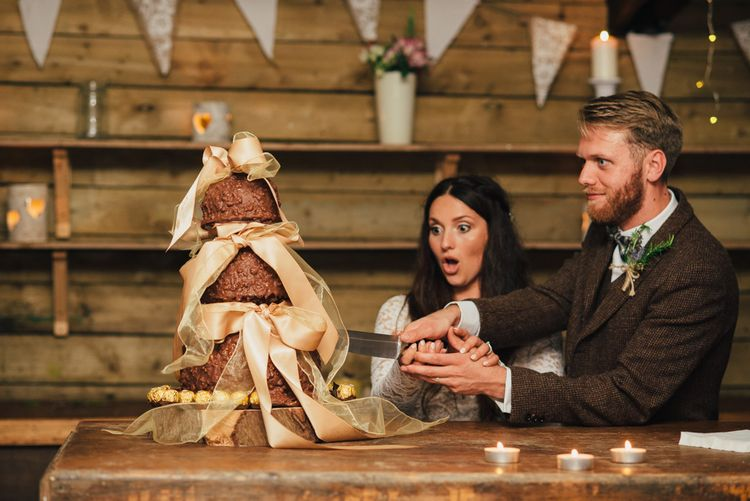 Cutting The Cake | Bride in Suzanne Neville Scarlet Gown | Groom in Harris Tweed Suit | DIY Woodland Wedding in South Wales | Cat Beardsley Photography