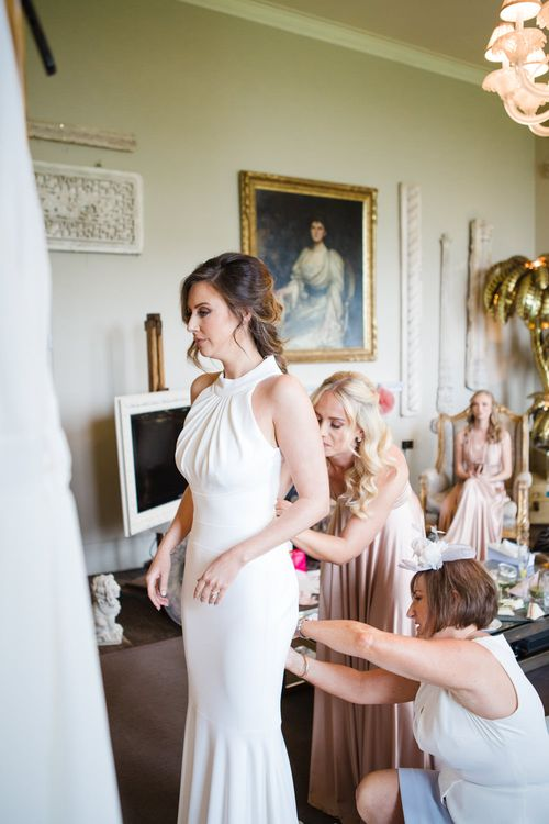 Bridal Preparations | Bride in Suzanne Neville Belle Gown | Elegant Wedding at Aynhoe Park, Oxfordshire | Lucy Davenport Photography