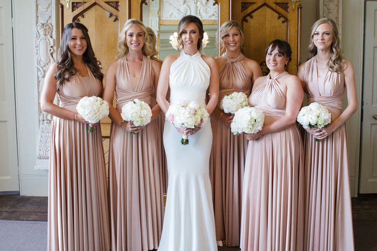 Bride in Suzanne Neville Belle Gown | Bridesmaids in Rosewater Twobirds Multiway Dresses | Elegant Wedding at Aynhoe Park, Oxfordshire | Lucy Davenport Photography