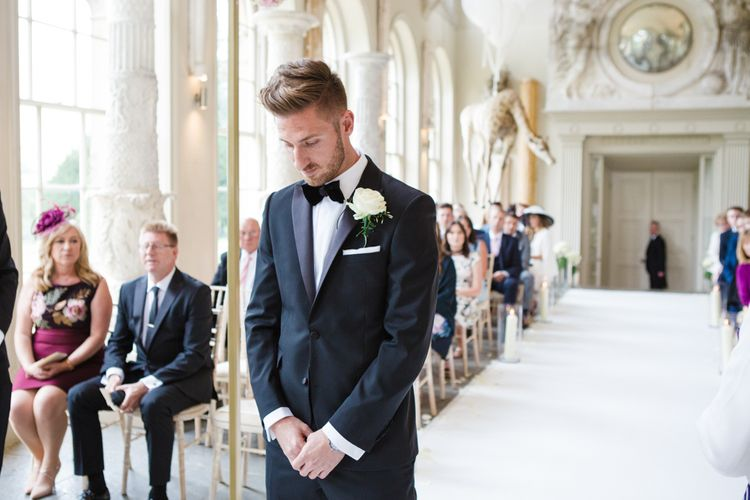 Groom in Black Tie DKNY Suit from Moss Bros. | Elegant Wedding at Aynhoe Park, Oxfordshire | Lucy Davenport Photography