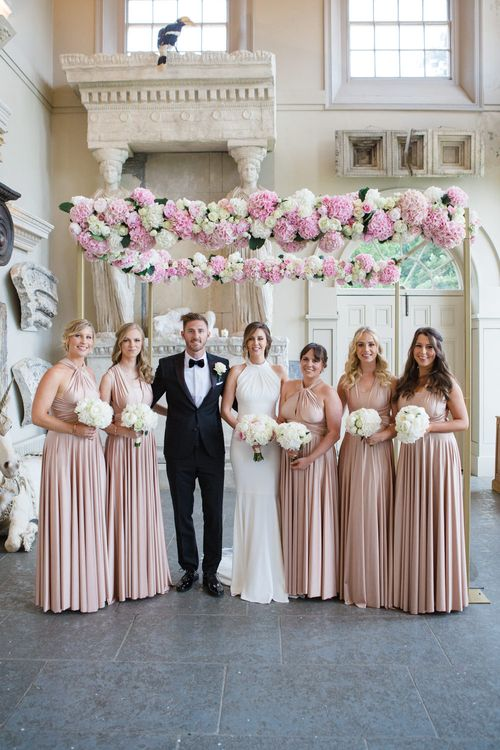 Bride in Suzanne Neville Belle Gown | Groom in DKNY Black Tie Suit from Moss Bros. | Bridesmaids in Rosewater Twobirds Multiway Dresses | Elegant Wedding at Aynhoe Park, Oxfordshire | Lucy Davenport Photography