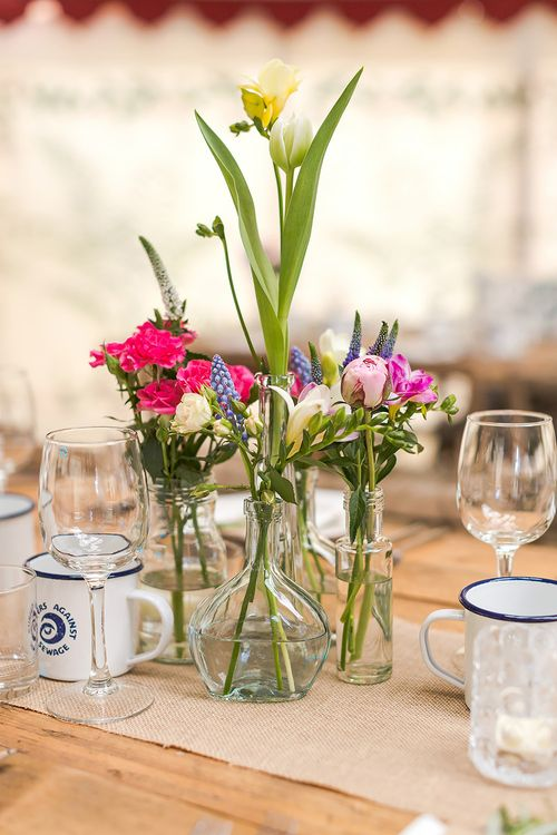 Spring Flowers In Bud Vases For Wedding