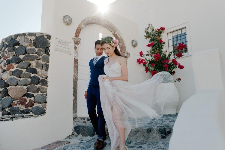 Stunning Santorini Elopement at Aenaon Villas. Watters Wedding Dress, Images by Nadia Meli.