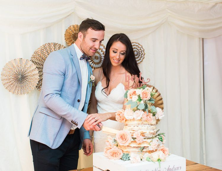 Cutting the Semi Naked Wedding Cake | Bride in Backless Katie May Gown | Groom in Zara Blazer & Topman Trousers | Sung Blue Photography | ROOST Film Co.