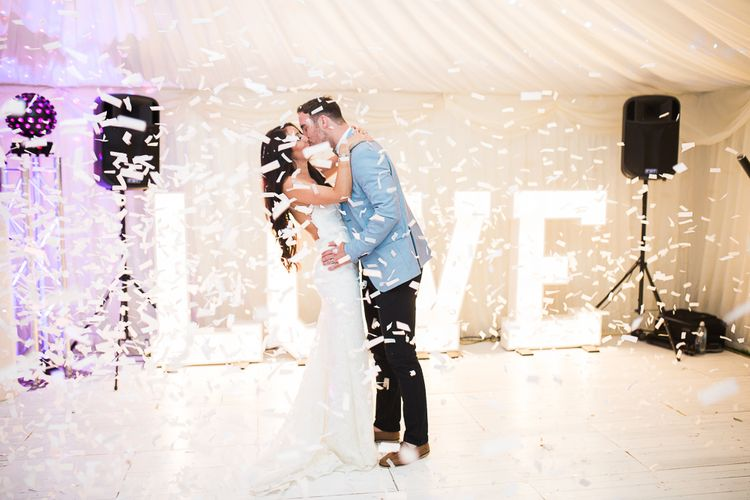 Confetti Dance Floor Moment | Giant LOVE Lights | Bride in Backless Katie May Gown | Groom in Zara Blazer & Topman Trousers | Sung Blue Photography | ROOST Film Co.