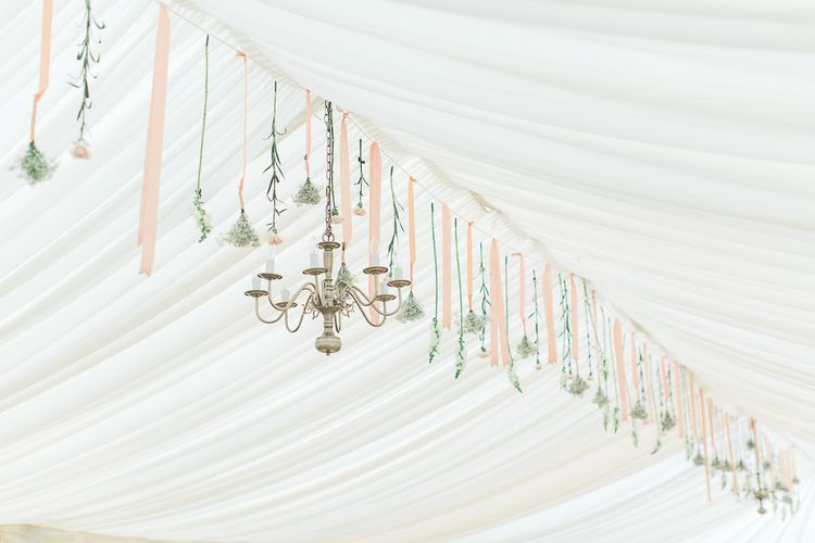 Chandelier & Hanging Floral Arrangement | Elegant Peach, Copper & Rose Gold At Home Marquee Reception | Sung Blue Photography | ROOST Film Co.