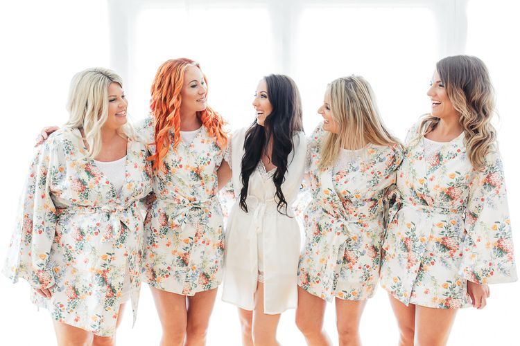 Bride in White Dress Gown | Bridesmaid in Floral Monsoon Dressing Gown | Sung Blue Photography | ROOST Film Co.