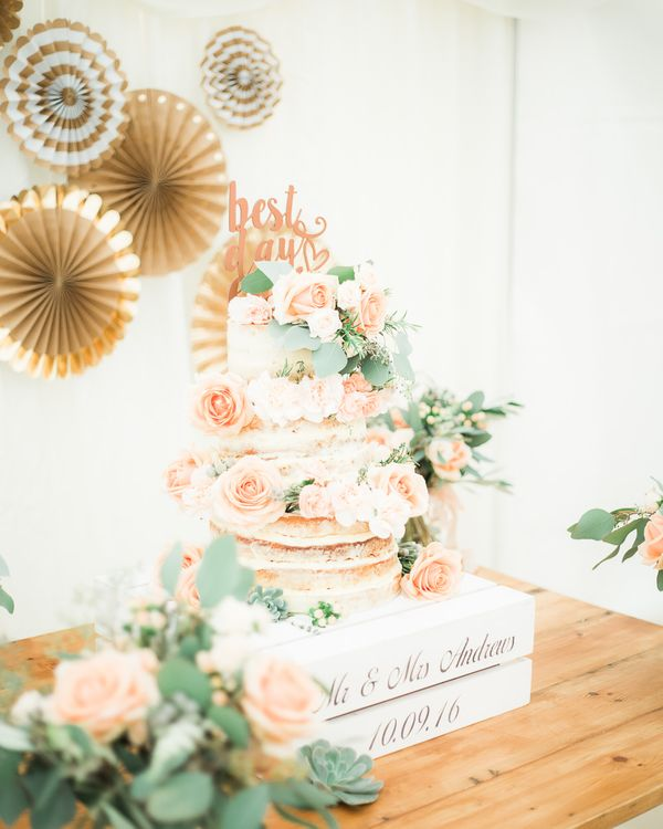 Semi Naked Wedding Cake on Rustic Crate | Elegant Peach, Copper & Rose Gold At Home Marquee Reception | Sung Blue Photography | ROOST Film Co.