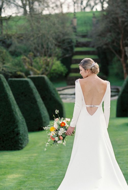 Backless Wedding Dress | Elegant Wedding Inspiration at Cornwell Manor with Floral Design by Bramble and Wild | Bowtie & Belle Photography | Carmencita Film Lab | Baxter and Ted Films