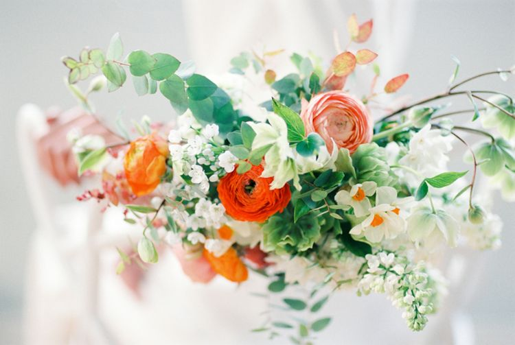 Orange Chair Back Decor | Elegant Wedding Inspiration at Cornwell Manor with Floral Design by Bramble and Wild | Bowtie & Belle Photography | Carmencita Film Lab | Baxter and Ted Films