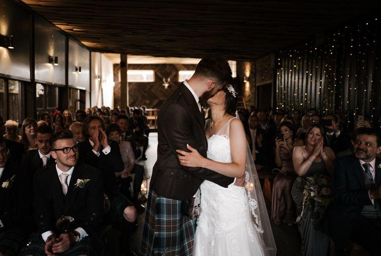 The Ceremony | The Kiss | Owen House Wedding Barn | Joyce Young London | Damian Brandon