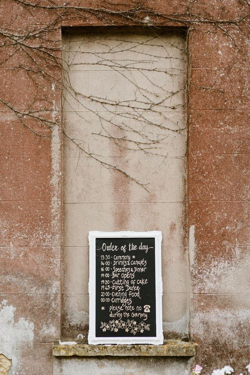 Chalkboard Order of the Day Sign | Outdoor Ceremony & Rustic Barn Reception at Pennard House Somerset | John Barwood Photography