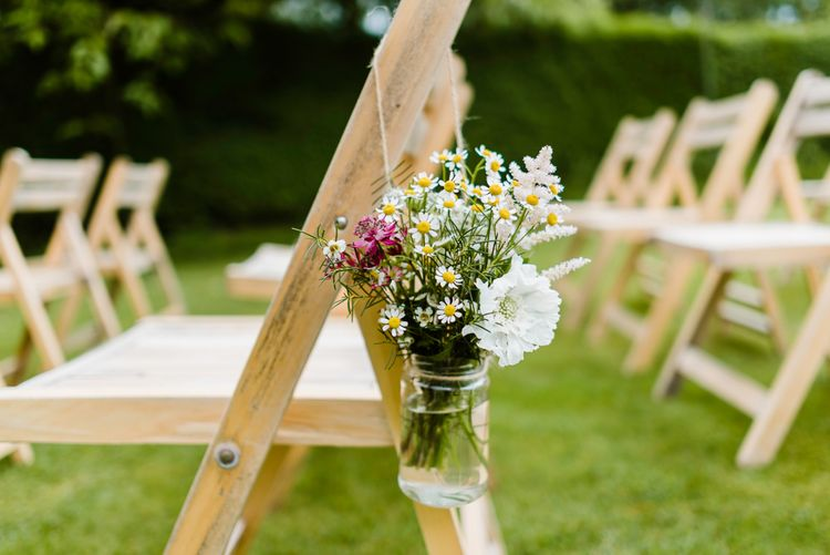 Aisle Chair Back Flowers | Outdoor Ceremony & Rustic Barn Reception at Pennard House Somerset | John Barwood Photography