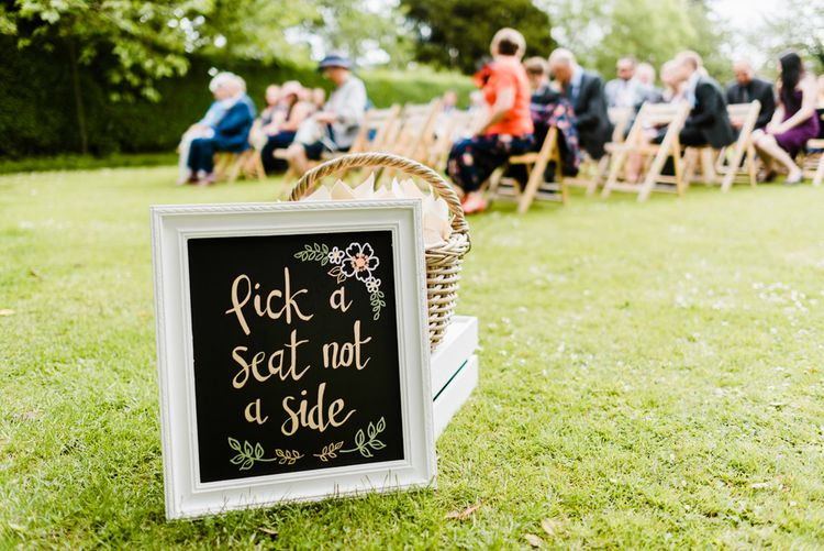 Pick a Seat Not a Side Ceremony Sign | Outdoor Ceremony & Rustic Barn Reception at Pennard House Somerset | John Barwood Photography