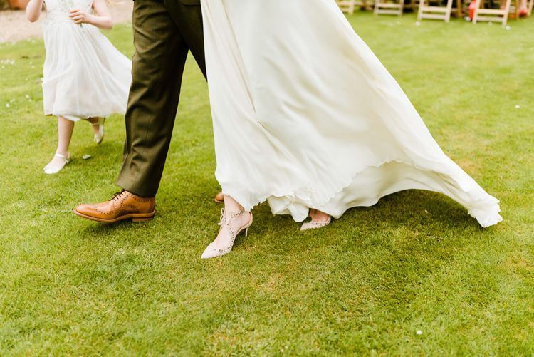 Wedding Ceremony | Aquazzura Bridal Shoes | Loake Brouque Grooms Shoes | Outdoor Ceremony & Rustic Barn Reception at Pennard House Somerset | John Barwood Photography