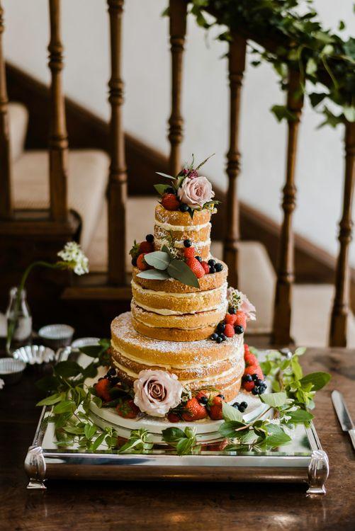 Naked Sponge Wedding Cake with Fruit Decor | Outdoor Ceremony & Rustic Barn Reception at Pennard House Somerset | John Barwood Photography