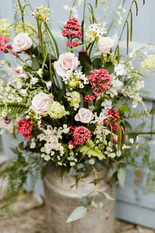 Milk Churn Floral Arrangement | Outdoor Ceremony & Rustic Barn Reception at Pennard House Somerset | John Barwood Photography