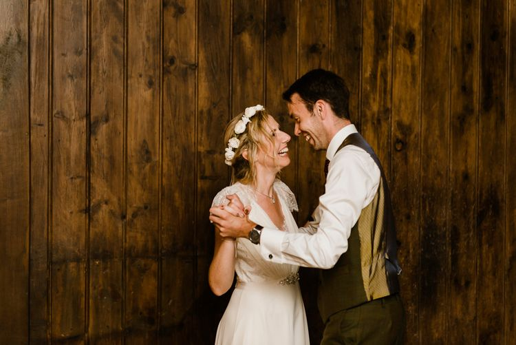 First Dance | Bride in Jenny Packham Gown | Groom in Hugo Morris Tweed Suit | Outdoor Ceremony & Rustic Barn Reception at Pennard House Somerset | John Barwood Photography