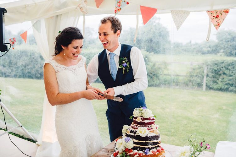 Cutting the Cake | Bride in Morlee | Groom in Hugo Boss Suit | DIY At Home Marquee Wedding | J S Coates Wedding Photography