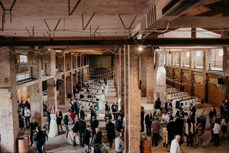 Industrial Wedding Venue with Festoon Lights | That Day Wedding Planner | Carla Penoncelli PhotographyIndustrial Wedding Venue with Festoon Lights | That Day Wedding Planner | Carla Penoncelli Photography