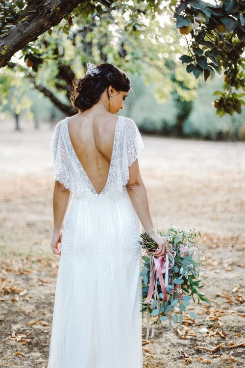 Bride in Jenny Packham Dolly Bridal Gown | Tropical Green & Fuchsia Pink Outdoor Wedding at Castellina de Miremont, Italy Planned & Styled by Come le Ciliegie Wedding & Events | Images by Effeanfotografie | Film by Headshot Weddings