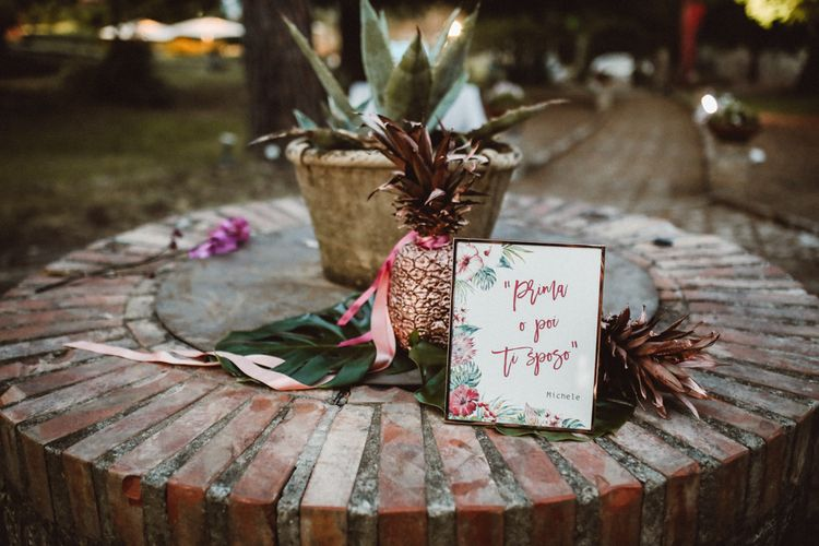 Spray Painted Copper Pineapple & Stationery | Tropical Green & Fuchsia Pink Outdoor Wedding at Castellina de Miremont, Italy Planned & Styled by Come le Ciliegie Wedding & Events | Images by Effeanfotografie | Film by Headshot Weddings